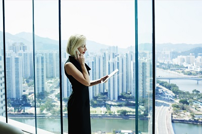 business woman talking on the phone while holding digital tablet
